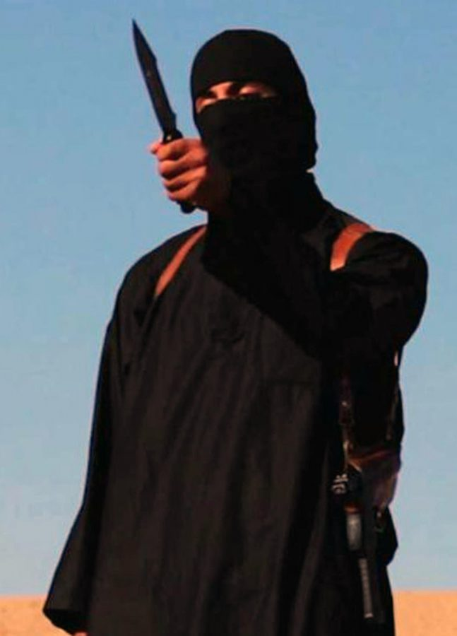 Mohammed Emwazi, a Kuwaiti-born man from London, has reportedly been identified as the masked man behind videos of ISIS beheadings. He's shown in this still from an ISIS video from September 14, 2014. (Ropi/Zuma Press/TNS)