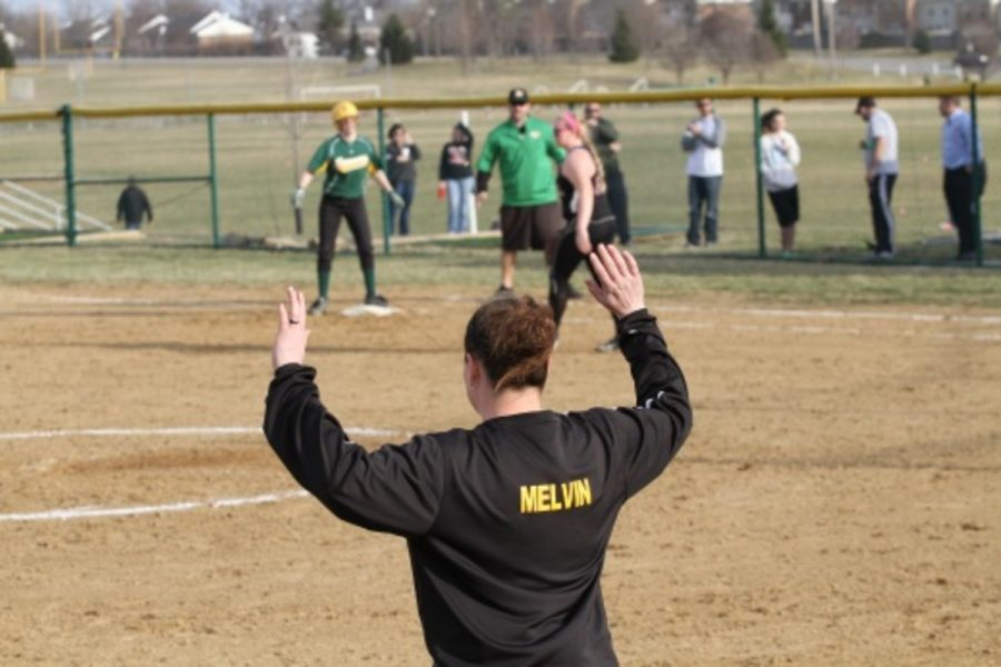 Coach Sarah Melvin has been doing everything in her power to help the players get a win. This includes hitting before the games and switching up the lineup. Photo courtesy of McDaniel's Photography.