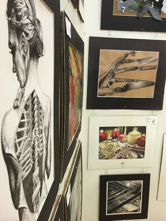 Senior Audrey Moeller displays her work during Fine Arts weekend in March. Moeller's final high school showing of her art took place on May 8 at the Senior Art Show. All students from AP Studio Art and AP Photography had the opportunity to showcase pieces from their portfolio for the Sycamore community.