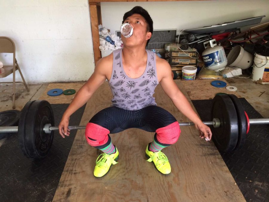 Junior Yangxing Ding performs one of his many eccentric warm ups before a lift. Ding, along with, juniors Misha Sweeney and Ajay Qi, hopes to start a SHS lifting team next year. Multiple juniors have already expressed interest in joining.