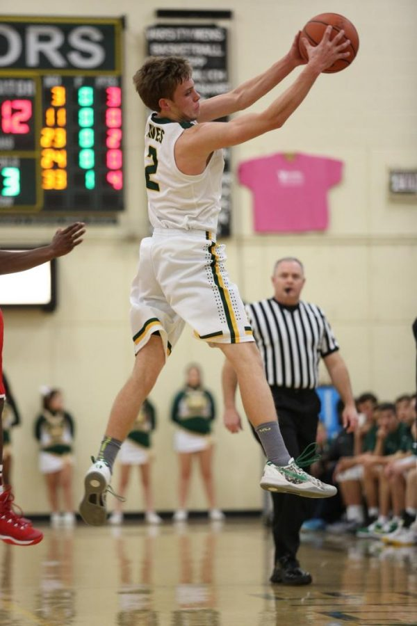 Senior Nick Gerlic is receiving the basketball during a game. Gerlic is one of four seniors graduating. The team is 4-18 with a playoff game this Friday. Photo courtesy of McDaniel's Photography.