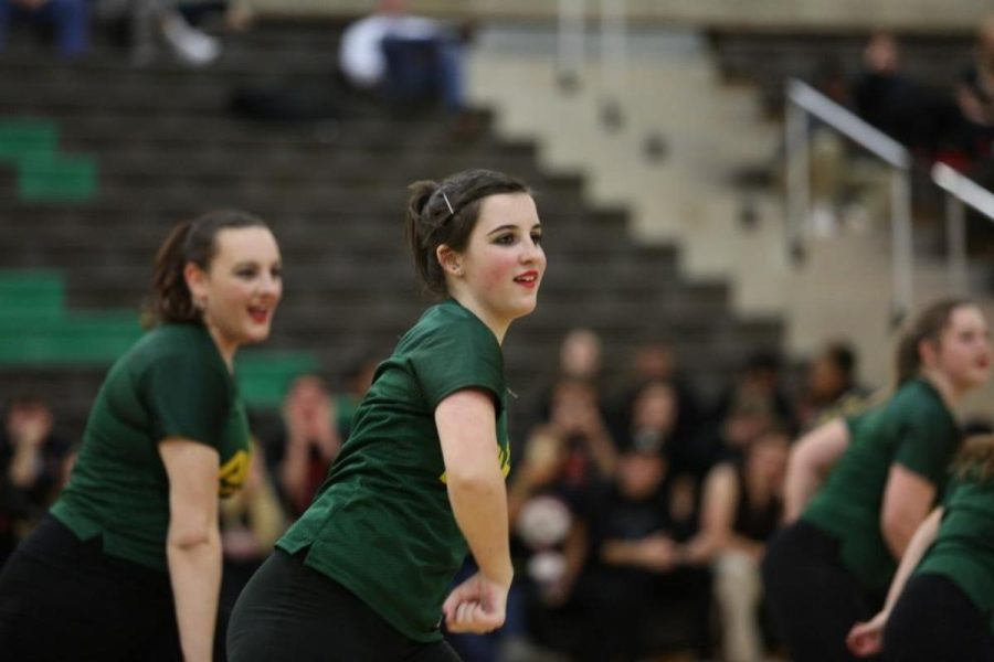 """Freshman Riley Kurtz and senior Emily Spry dancing at a boys Varsity basketball game. """"Summer practices start in August with dance camp at Miami University for three days. At camp we learn multiple routines and work on technique,"""" said Davis. Photo courtesy of McDaniel's Photography."""
