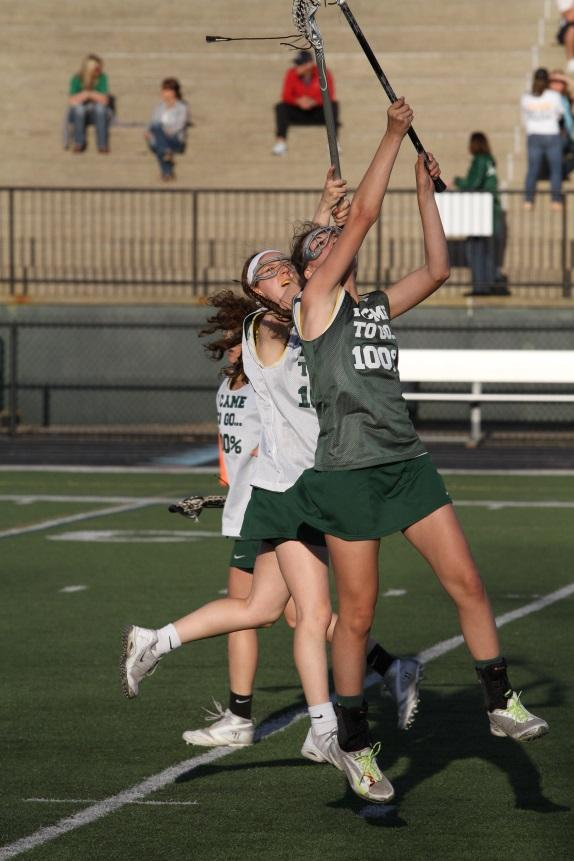The girls' lacrosse team is doing a scrimmage last season. To prepare for this season they have had scrimmages. The returning state champions lost eight seniors but are ready to show they are still talented. Photo courtesy of McDaniel's Photography.
