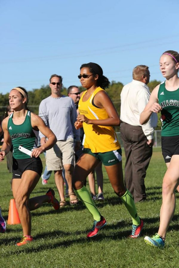Sophomore Kamaria Walton runs at a Cross Country meet. Teams like Cross Country would benefit from a new outdoor track. However, many students believe that there is nothing wrong with the track we have now.