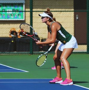 Varsity Gold members lost to Mason 2-3. Skwara and senior Alexandra Abele won their matches. A supportive crowd can make a big difference for the outcome of a match.