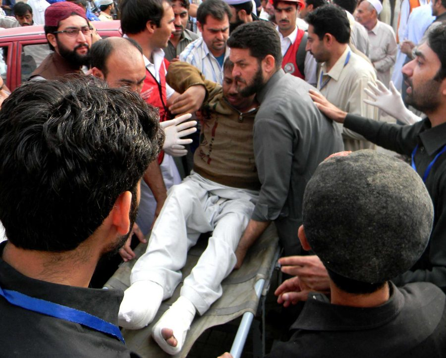 Pakistani people transfer an injured man to a hospital after a severe earthquake on Oct. 26, 2015 in northwest Pakistan's Peshawar. At least 100 people were killed and over 400 others injured when an earthquake measuring 8.1 at Richter Scale hit Pakistan on Monday, local media and met office said. (Ahmad Sidique/Xinhua/Zuma Press/TNS)