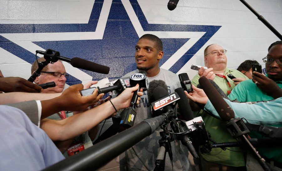 Gay and former football player Michael Sam is talking to the media when he was signed to the Dallas Cowboys practice squad. He came out as the first gay player in 2014 before the April draft.  He came out to his college team, the University of Missouri but they kept it a secret during the 2013 season.