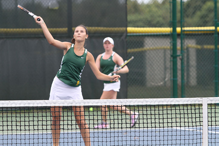 Freshman+Helen+Sotropa+is+hitting+a+ball+back+during+warm+ups+before+senior+night+for+girls+Gold+Varsity+tennis+on+Friday+Sept.++25.+They+played+Chaminade-Julienne+and+won+5-0.+The+girls+went+on+to+state+on+Sunday+Oct.+18+and+became+state+runner+ups.+