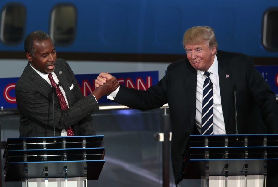 Republican+presidential+candidates+Ben+Carson+and+Donald+Trump+grasped+hands+during+the+Sept.+16+GOP+debate.+The+two+are+number+three+and+number+one+in+the+polls+respectively.+Carson+has+been+gaining+support+rapidly%2C+especially+after+he+stated+that+he+would+not+support+a+Muslim+president.