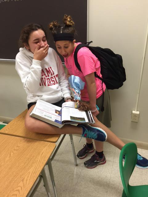 Freshman+Ava+Vilardo+and+Sarah+Wertheim+are+reading+during+Ace+bell.++It+was+senior+night+for+water+polo%2C+so+Sarah+is+in+the+ensemble+the+seniors+chose+for+her-complete+with+a+Barbie+doll.++The+girls+read+everyday+in+Ace+bell.