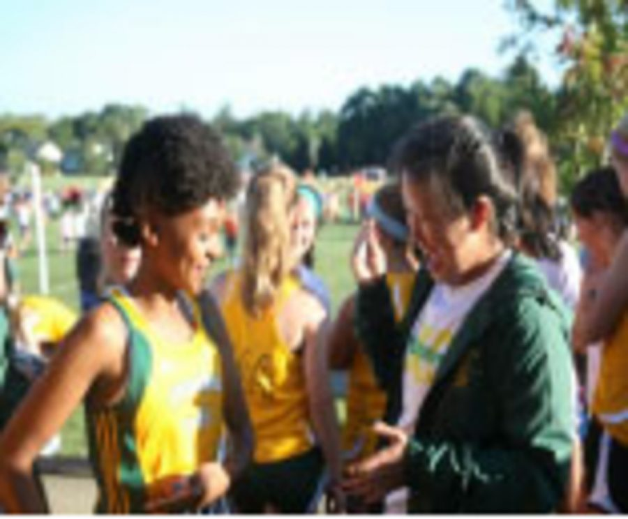 Anita+Pan+and+Jaslyn+Davis+Johnson%2C+sophomores%2C+laughing+together+at+Sunset+meet.+Sunset+was+the+girls%E2%80%99+first+competitive+meet.+They+have+been+running+cross+country+together+since+7th+grade.