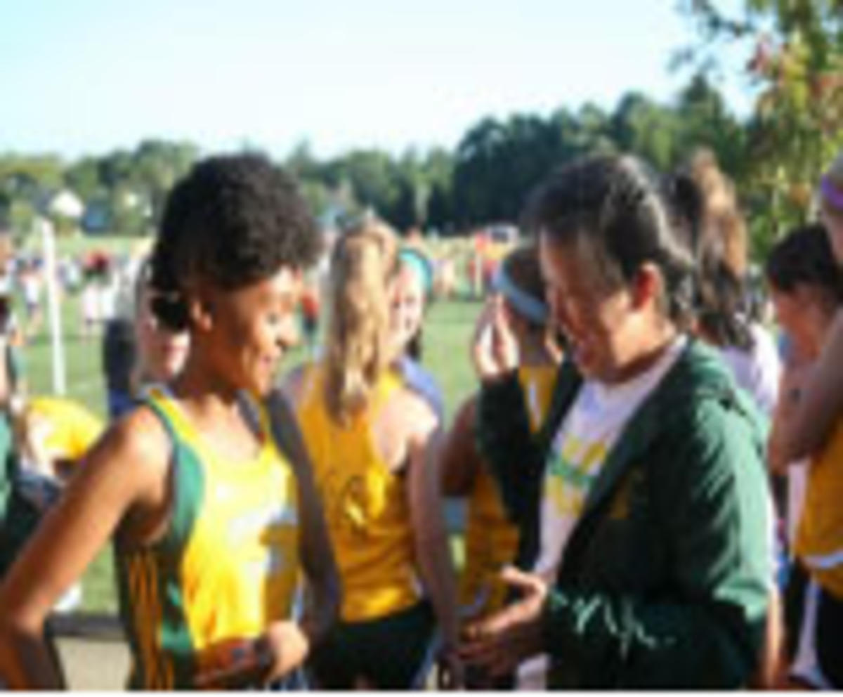 Anita Pan and Jaslyn Davis Johnson, sophomores, laughing together at Sunset meet. Sunset was the girls' first competitive meet. They have been running cross country together since 7th grade.