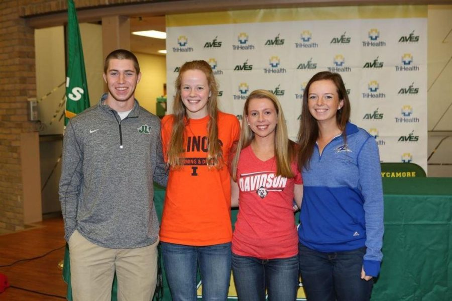 Athletic+Director+Phil+Poggi+lead+the+signing+ceremony%2C+which+featured+the++signings+of+four+student+athletes.+Over+100+friends+and+family+were+in+attendance.+Senior+Mary+Fry+said+%E2%80%9CIt+was+really+cool+to+be+up+on+stage+with+some+of+my+closest+friends+and+seeing+all+of+the+people+who+came+to+support+all+of+us.%E2%80%9D%0A