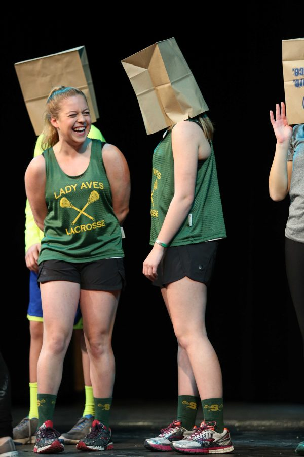 Senior Mackenzie McMullen and sophomore Megan McMullen participate in Battle of the Sibs in 2015. They were working to raise money for Juvenile Diabetes Research Foundation. Battle of the Sibs is an annual event that involves sibling pairs from ten families competing to win the money raised for their chosen charity.