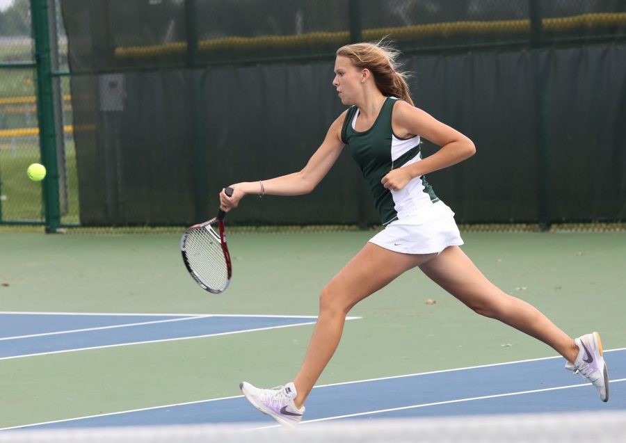 Sophomore Bryce Winnestaffer in an action shot. She has been playing on the SHS tennis team for two years. She continues to play singles, playing second singles this year. Photo by McDaniel's Photography.