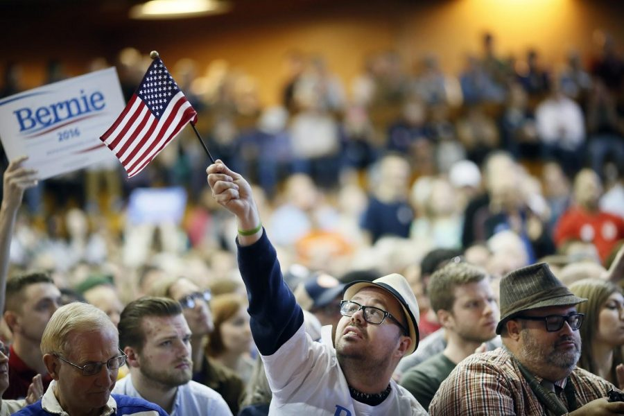 Christopher Krauss waves an American flag during a rally for Sen. Bernie Sanders at the American Indian Center on Sunday, May 31, 2015, in Minneapolis. (Jerry Holt/Minneapolis Star Tribune/TNS)