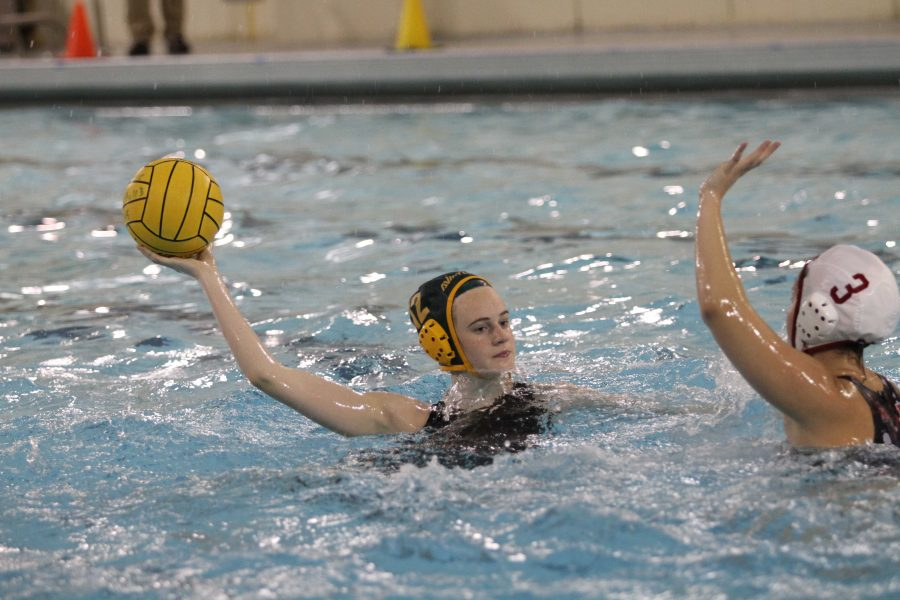Senior team captain Hannah Kast lining up to shoo the ball. Kast is a two year varsity starter, and is one of the leaders on this team. Kast plays hole defense.
