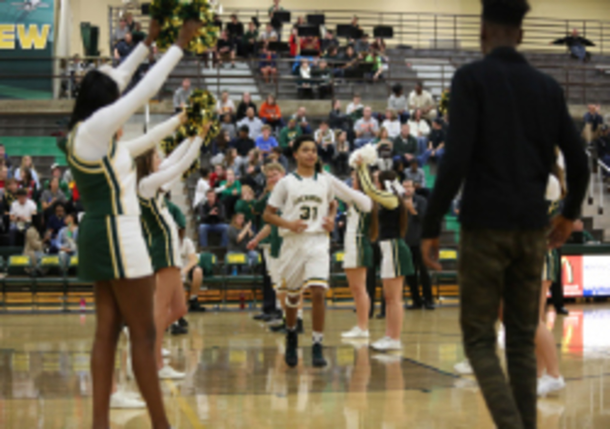 Varsity boys basketball defeats Milford, drops GMC opener to Middletown