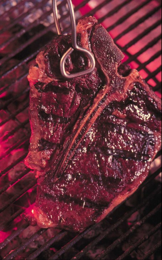 KRT+FOOD+STORY+SLUGGED%3A+STEAKS+KRT+PHOTOGRAPH+BY+MARY+KELLEY%2FCOLORADO+SPRINGS+GAZETTE+TELEGRAPH++%28KRT3-September+28%29++Uptown+cuts+of+steak%2C+like+this+T-bone%2C+require+little+preparation+for+grilling+according+to+William+Rice+author+of+the+%27%27Steak+Lover%27s+Cookbook%27%27++Rice+classifies+the+most+tender+cuts+of+steak%2C+such+as+T-bone%2C+ribeye+and+top+lion%2C+as+uptown+cuts.+%28GT%29+AP+PL+KD+1998+%28Vert%29+%28Additional+photo+available+on+KRT+Direct%2C+PressLink+or+upon+request.%29+NO+MAGS%2C+NO+SALES