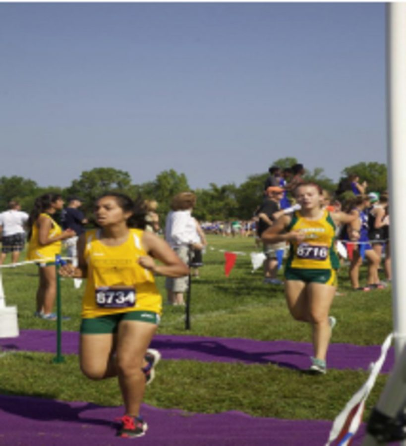 Senior+Marisa+Koster+has+a+stress+reaction+in+the+metatarsal+of+her+foot.+She+participated+at+the+Lebanon+invitational+Saturday+September+5th.++Through+the+pain%2C+she+crossed+the+finish+line.+Also+pictured%2C+Michelle+Siddiqui.+