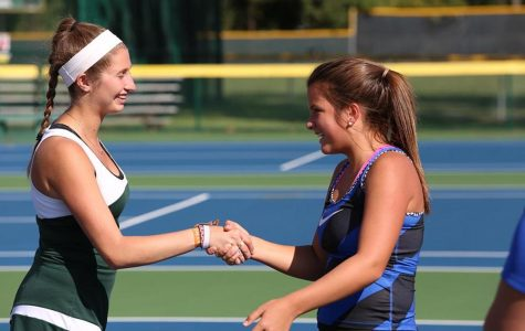 Senior Melissa Goodman shakes her opponent''s hand prior to their match. Each match, the captains of each team call out the student playing each position on the team before the players begin their match. Goodman played first doubles during the season.