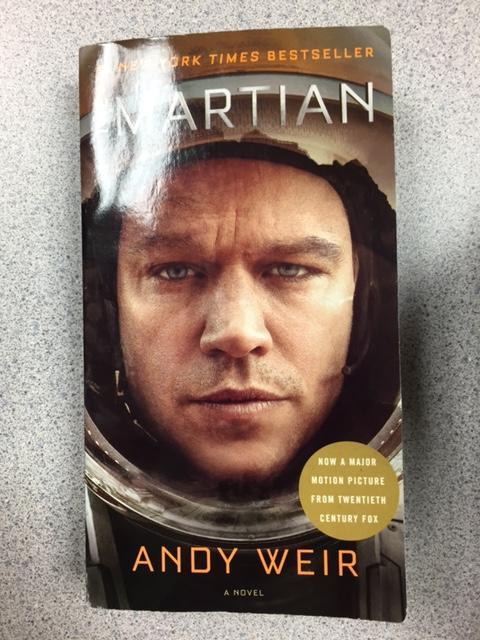 """""""The Martian"""" by ANdy Weir is about a man who gets trapped on Mars. THe book follows his logs as he presents his struggles with creating creative ways to fix his issues. The book was also created into a movie, which was applauded by NASA."""
