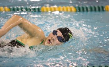 Junior Isabelle Jimenez swims the 200 freestyle at a meet over winter break. The swimmers have 5 more meets this season. The last meet will be the state meet in late Feb.