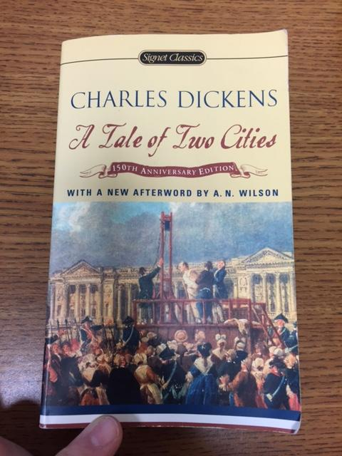 Sophomores are reading A Tale of Two Cities. The book is about the French Revolution and the parallel situation in London. The students formed reading groups to help remove confusion.