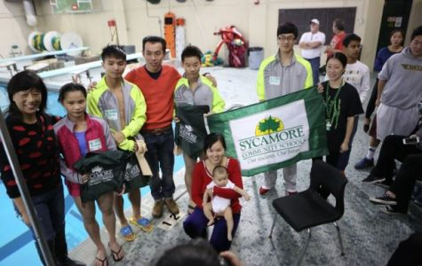 He, Ling, Zhang, and they're coach Ding pose for a photo.  With them are parents, and siblings.  Chinese Club members look on in interest:  from left to right, Sophomore Sharyhua Singhe, Deng, and Jannen Suva-check spelling.  The event ended around 3:30 PM.