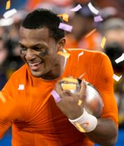 The quarterback of Clemson University: Deshaun Watson celebrates a victory after beating the University of North Carolina in the ACC Championship game. This game punched the ticket for Clemson to head to the College Football Playoff. Clemson is ranked number one in the nation. Photo courtesy of: MCT Photography.