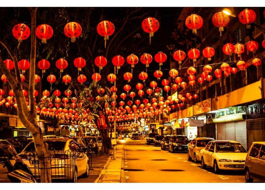 """Another tradition for Chinese New Year is for adults to give children """"hong bao,"""" little red envelopes of money. The dragon is also a part of many Chinese traditions. Everything is red for good luck."""