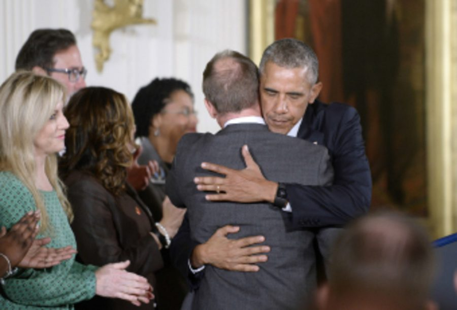 President+Barack+Obama+hugs+Mark+Barden%2C+father+of+a+Sandy+Hook+victim.+This+issue+hits+close+to+home+for+Obama+because+he+has+two+daughters+of+his+own+that+could+be+affected+by+this+same+type+of+violence.+The+United+States+will+likely+see+revised+gun+laws+in+the+future+because+of+this.+%0A