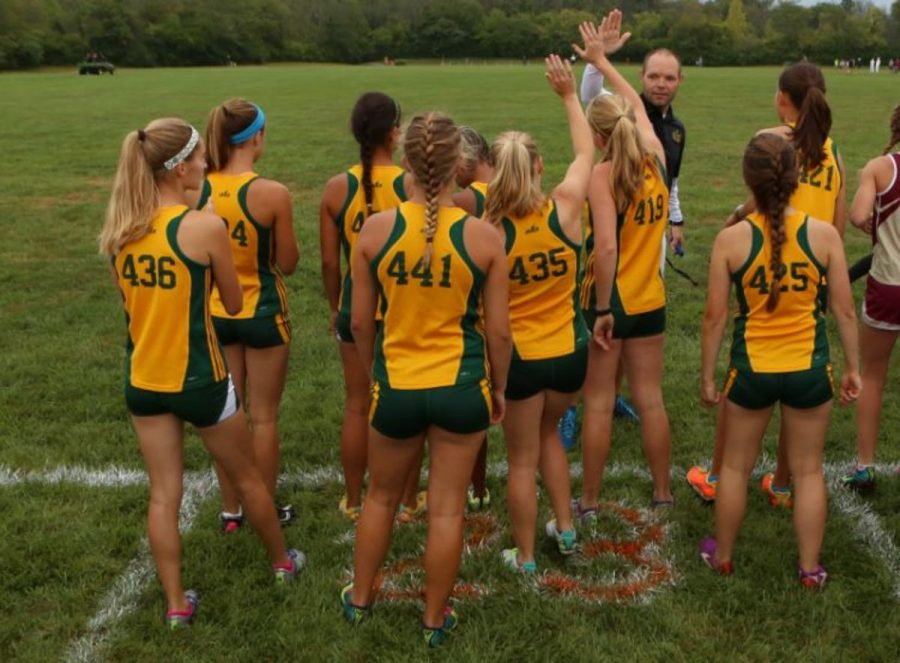 Varsity+runners+line+up+to+begin+warming+up+before+their+race+at+Mason.+Sycamore+is+in+division+one+of+the+races.+Coach+Greg+Pottebaum+encourages+each+girl+before+the+race.+All+photos+by+Jeremy+McDaniel.+