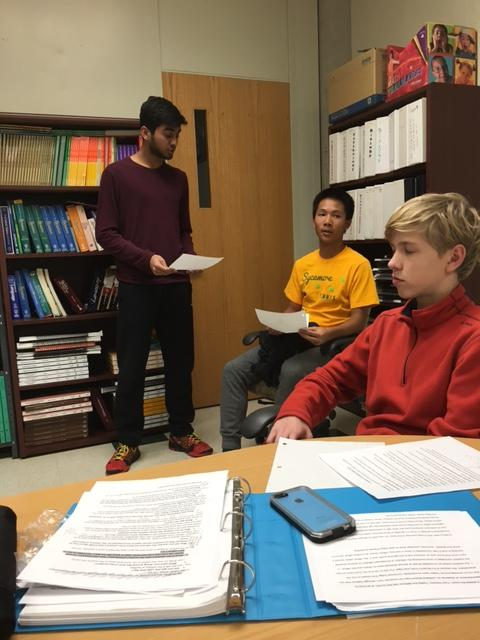 Attorneys+for+the+Green+team+sophomores+Rishav+Dasgupta+and+Adam+Meller+and+freshman+witness+Astin+Wong+practice+a+cross+examination+for+Wong%E2%80%99s+character%2C+%E2%80%9CPat+Sweeney.%E2%80%9D+In+the+real+competition%2C+Wong+will+be+crossed+by+an+attorney+from+the+opposing+team%2C+but+the+team+practices+together+to+prepare+one+another+for+the+possible+responses+or+questions+that+opponents+may+have.