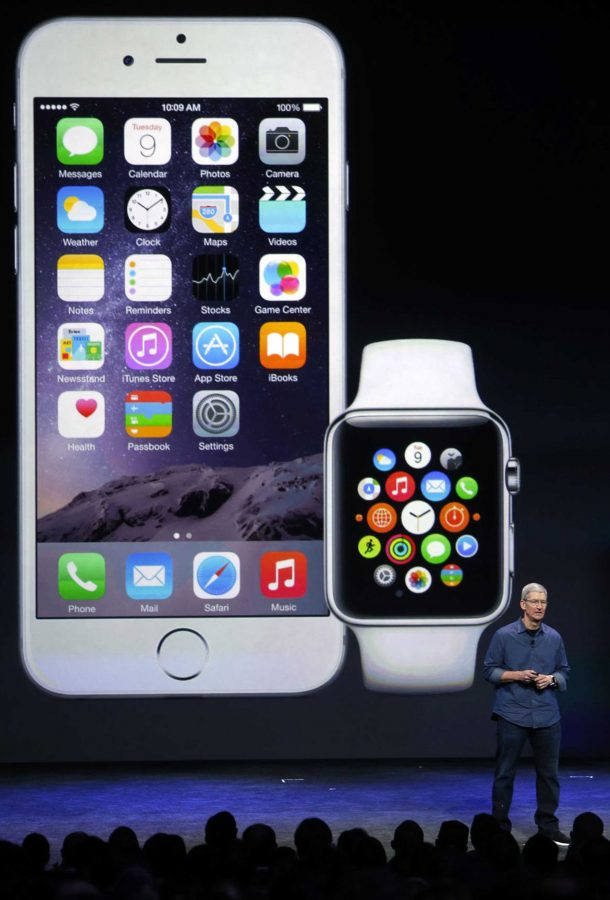 Apple CEO Tim Cook introduces the iPhone 6 and the Apple smartwatch at the Flint Center on Sept. 9, 2014, in Cupertino, Calif. (Karl Mondon/Bay Area News Group/TNS)
