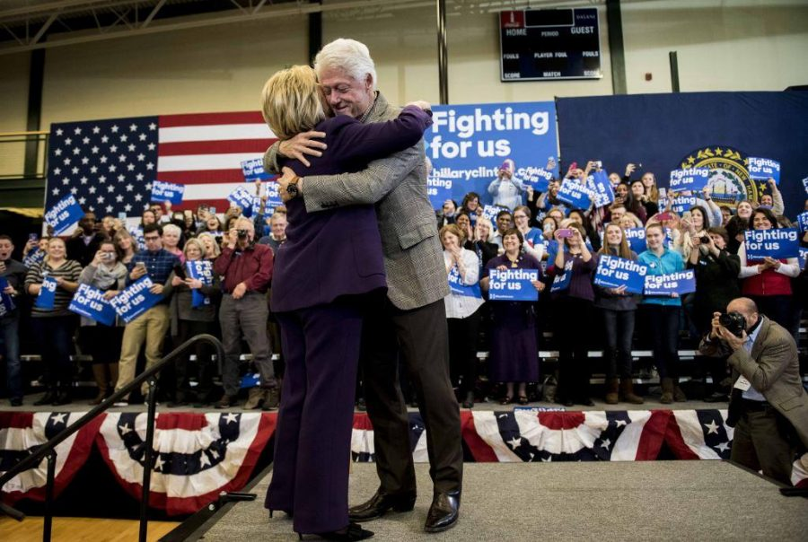 Clinton+hugs+President+William+Clinton+after+hearing+news+of+her+marginal+victory+over+Sanders.++This+photo+was+taken+at+Nashua+Community+College%2C+in+Nashua%2C+N.H.++Her+supporters%2C+toting++the+%E2%80%9CFighting+for+us+%E2%80%9C+signs%2C+stand+in+the+background.++