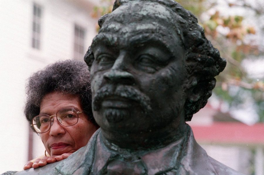Helen Fields, the great great granddaughter of Robert Smalls, stands with his monument in his hometown of Beaufort, South Carolina.