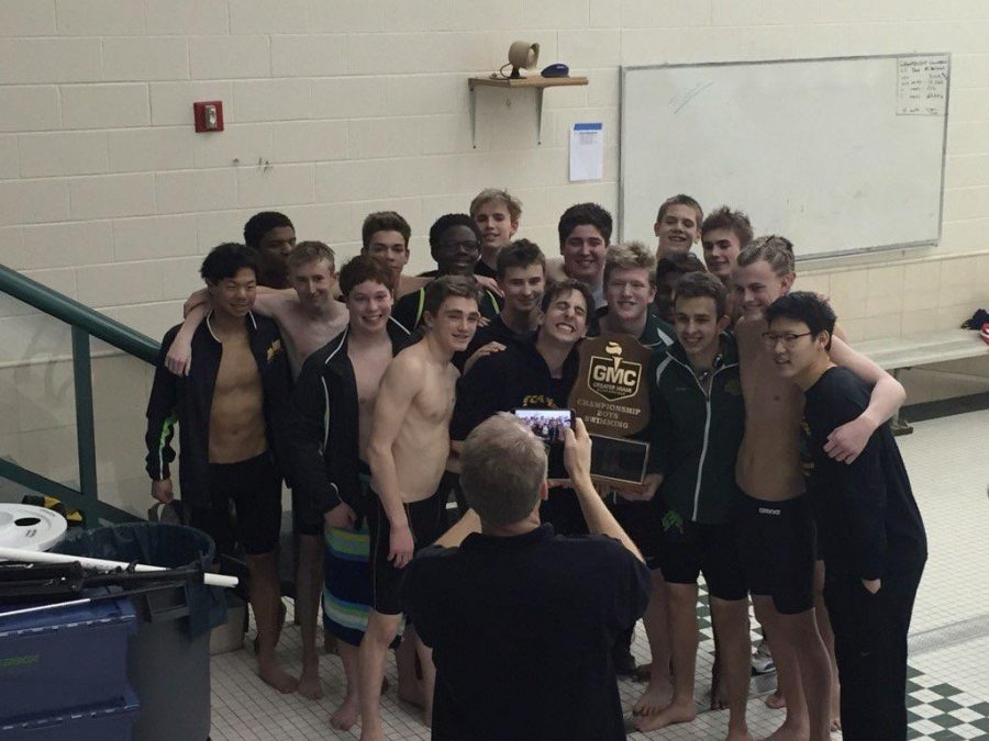 2015-16+boys+swim+team+holding+the+GMC+championship+trophy.+This+was+the+first+time+the+boys+won+the+trophy+since+2012-13.+