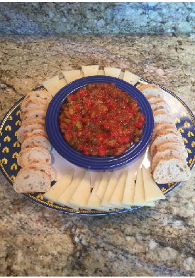 """Every year, Spanish IV classes research the numerous regions in Spain and present a project about the interesting cultures and facts about their region. In addition to presenting their project, each student is required to make a dish originating from the region that they researched. Sophomore Matthew Isakson said, """"For my project I created a Spanish dish called Pisto Manchego from my region, Castilla La Mancha."""""""