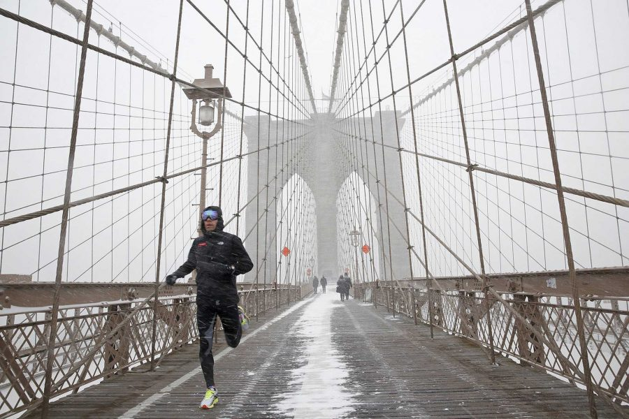 A New Yorker jogs on the structurally deficient Brooklyn Bridge. The danger of busy urban bridges under misrepair is the greater potential for lost life should people be on the bridge if it collapses. The Brooklyn Bridge is not the only New York City bridge to be unsound; the Tappan Zee is a large concern as the Manhattan Construction Attorney believes that it could collapse at any moment.