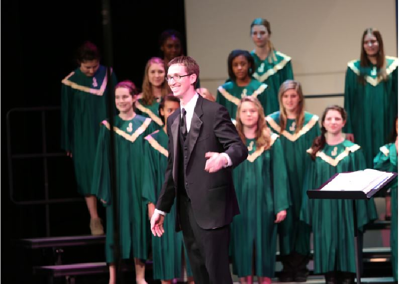 Mr. Ken Holdt conducts for one of the choral concerts. The choirs perform five concerts and competes in one competition each year. The choir students are preparing to go to a competition on Mar. 11, 2016 at Eaton High School.