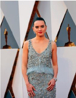"""Daisy Ridley poses on the red carpet at the 2016 Academy Awards.  She is known for being the main female protagonist for the new Star Wars movie sequel """"The Force Awakens.""""  This is her first feature film."""