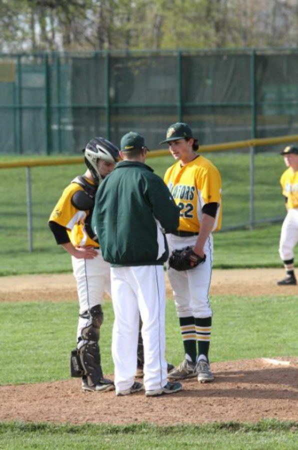 In a game from the 2015 season, now juniors Joshua Glynn (catcher) and Victor Garnica (pitcher) talk with a coach on the pitcher's mound. Last season, Garnica compiled 11 strikeouts over 32 innings. Garnica is one of 12 returning Varsity players.