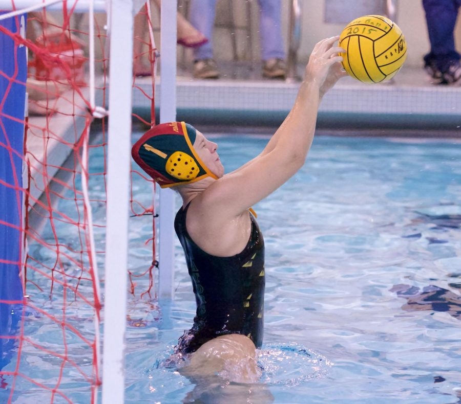 Sophomore Abigail Hausfeld jumps to block the ball. Hausfeld was the Varsity goalie as a sophomore. She plans to play with the local club team Moose Water Polo in the spring and summer.