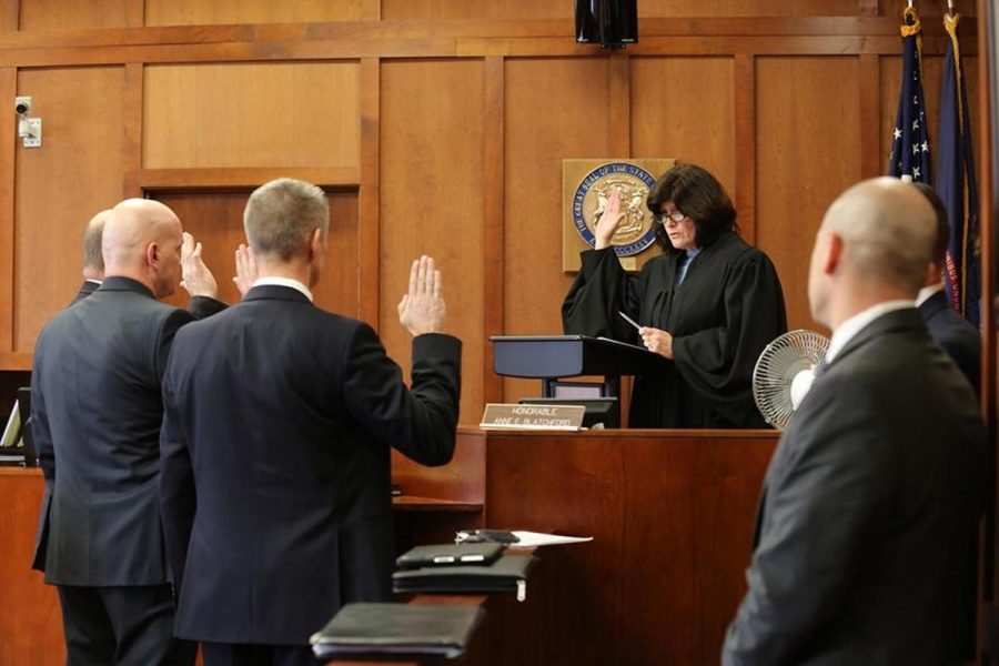 A judge swears in witnesses before the court. Later in the year, students in the class will do a pretend trial. The field trip will be an example for them to learn from.