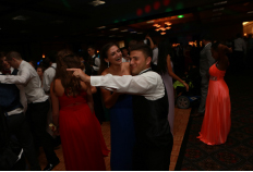 Senior Raquel Levitt dances with her date at Prom 2015. SHS students look forward to prom this year and hope that their prom is worth the costs that it might require.