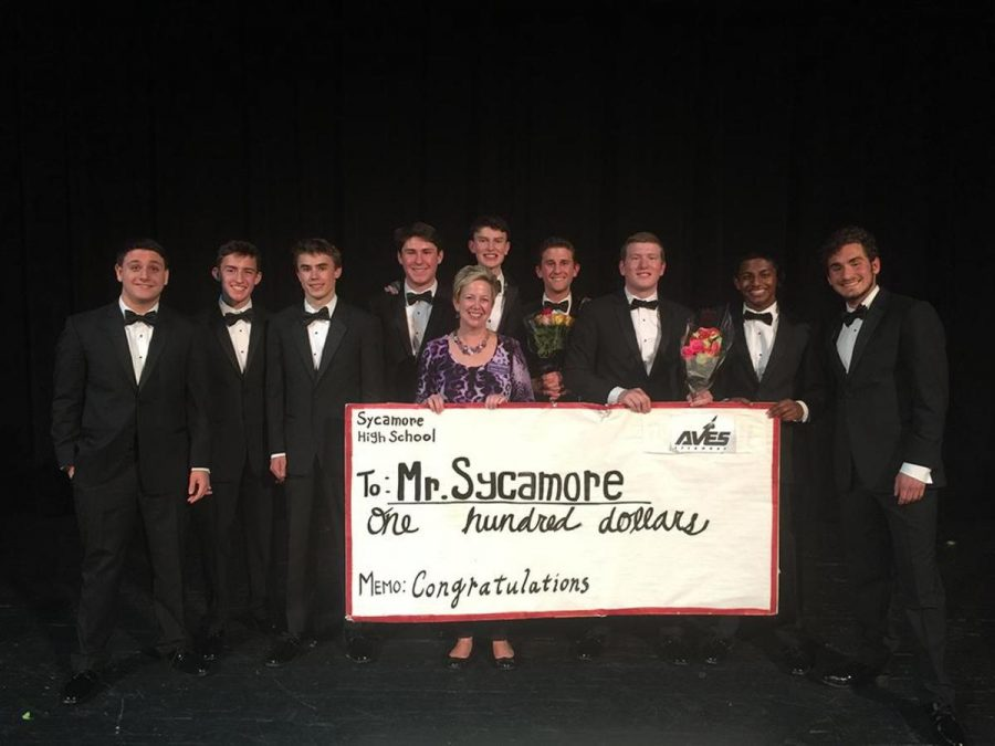 Mr.+Sycamore+was+able+to+raise+over+%241%2C500+for+the+Alzheimer%E2%80%99s+Association+on+Apr.+1.+Photographed+from+left+to+right+is+freshman+Drew+Lawrence+and+Luis+Pereda%2C+sophomores+Jack+Rose+and+Trevor+Size%2C+senior+Max+Poff%2C+Alzheimer%E2%80%99s+coordinator+Diana+Bosse%2C+junior+Mason+Taylor%2C+senior+Chris+Seger%2C+junior+Jannan+Sivaruban%2C+and+senior+Michael+Heyn.