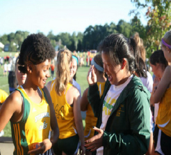 Davis-Johnson  and her friend Anita Pan during their first cross country meet of 2015.  She has been varsity runner for the girls Cross Country team since her freshmen year.  Davis-Johnson plans to continue running for SHS her entire high school career.