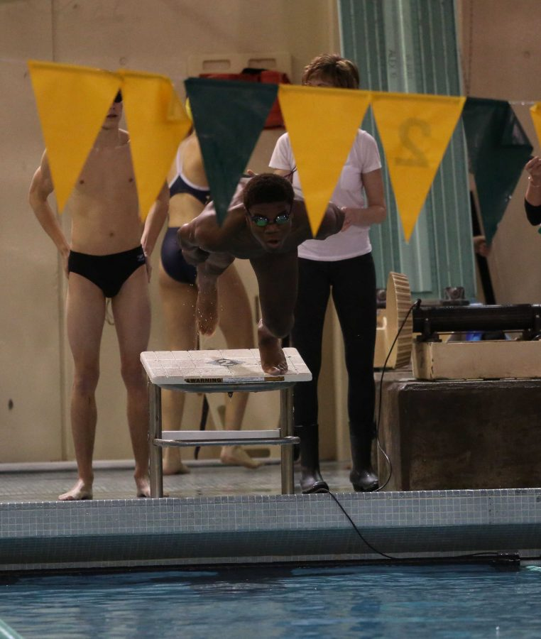Freshman Robert Schramm dives in to swim the 200 individual medley. With the new pool, there is talk of buying a new scoreboard. The ventilation system was also improved in the winter of 2015.