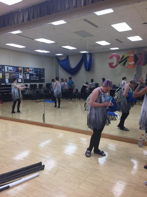 """The winter guard groups gets ready for the performance on April 30th. The group practiced and performed in the Little Theatre. The song they danced to was """"Falling"""" by Florence and the Machines."""